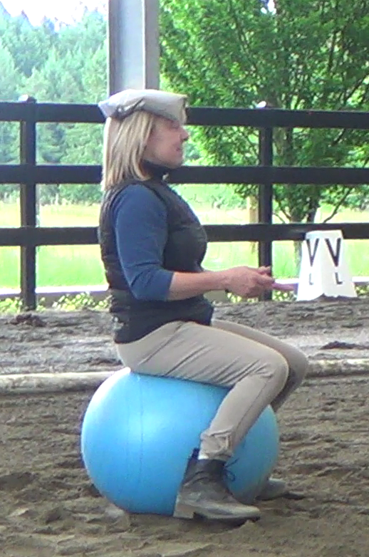 Meryle balancing in riding position on an exercise ball