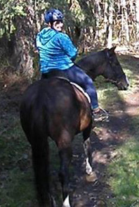 Lyz Rudolph Michaels and Shorty on a trail ride